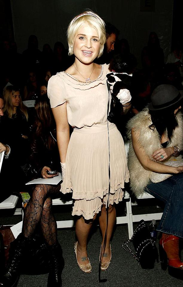 """Kelly Osbourne showed off a fabulously slim figure, and her adorable Pomeranian pooch, Sid, at the Michael Angel show. Brian Ach/<a href=""""http://www.gettyimages.com/"""" target=""""new"""">GettyImages.com</a> - February 11, 2010"""