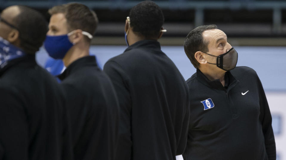 Duke coach Mike Krzyzewski lines with his players for for the national anthem for the team's NCAA college basketball game against North Carolina on Saturday, March 6, 2021, in Chapel Hill, N.C. (Robert Willett/The News & Observer via AP)