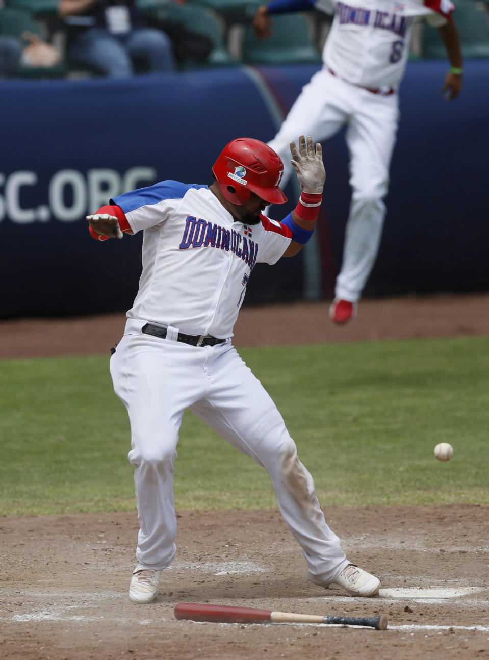 Dominican Republic catcher Charlie Valerio arrives safe at home plate after he scored a run against Venezuela during a final Olympic baseball qualifier game, in Puebla, Mexico, Saturday, June 26, 2021. (AP Photo/Fernando Llano)