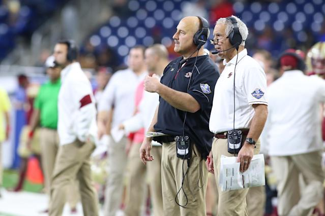 BC head coach Steve Addazio (L) and assistant coach Paul Pasqualoni talk during the Eagles' bowl game last season. (Getty)