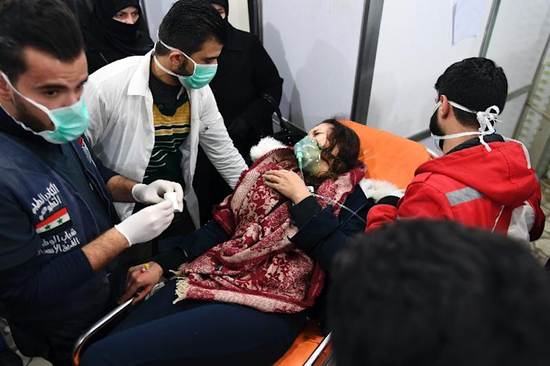 A Syrian woman receives treatment at a hospital in Aleppo on November 24, 2018, following an alleged gas attack
