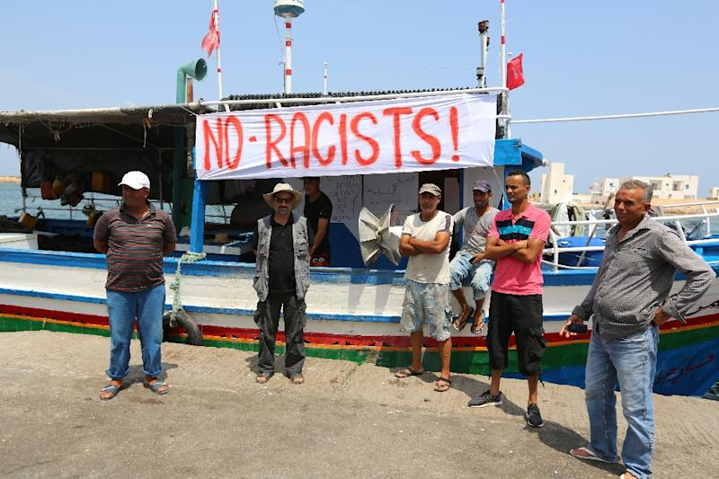 Tunisian fishermen gather on August 6, 2017 in the port of Zarzis in southeastern Tunisia to protest against a possible berthing of the neonazi anti-refugee C-Star vessel (AFP Photo/FATHI NASRI)