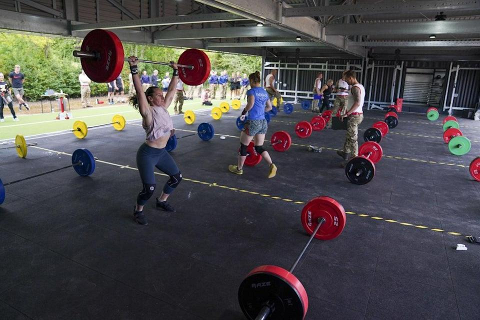 Soldiers compete in the weightlifting task (Steve Parsons/PA) (PA Wire)