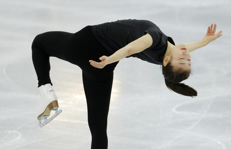 Figure skater Yuna Kim of South Korea skates in the practice rink at the 2014 Winter Olympics, Thursday, Feb. 13, 2014, in Sochi, Russia. (AP Photo/Vadim Ghirda)