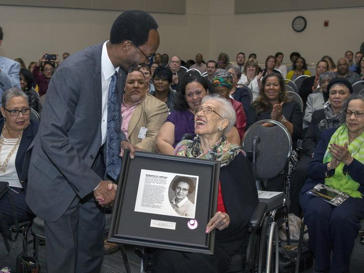Clayton Turner presents Katherine Johnson with a plaque