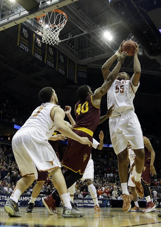 Texas center Cameron Ridley (55) goes up for the game winning shot against Arizona State during the second half of a second-round game in the NCAA college basketball tournament Thursday, March 20, 2014, in Milwaukee. Texas won 87-85. (AP Photo/Morry Gash)