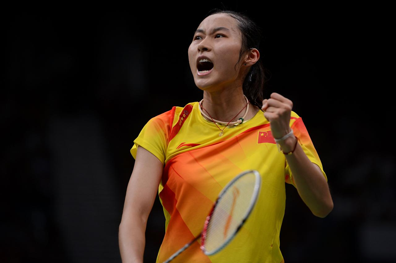 LONDON, ENGLAND - AUGUST 03:  Yihan Wang of China celebrates in the Women's Singles Badminton Semi-Final against Saina Nehwal of India on Day 7 of the London 2012 Olympic Games at Wembley Arena on August 3, 2012 in London, England.  (Photo by Michael Regan/Getty Images)