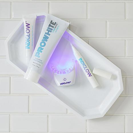 The bright purple light gently but effectively whitens your smile. (Photo: HSN)