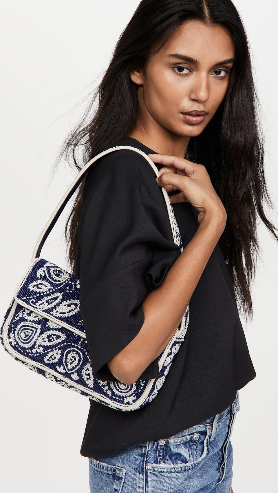 <p>The print on this <span>STAUD Tommy Beaded Bag</span> ($250) will surely make a statement. We already want to wear it with jeans and sweater for fall.</p>