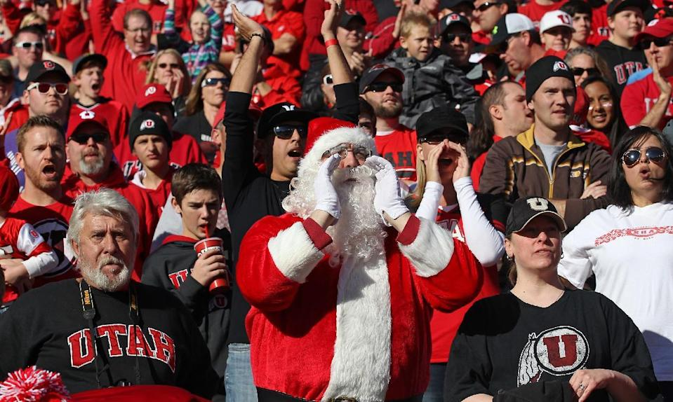 A Utah fan dressed as Santa Claus shows his support in the first half during an NCAA college football game against Colorado Saturday, Nov. 30, 2013, in Salt Lake City. (AP Photo/Rick Bowmer)