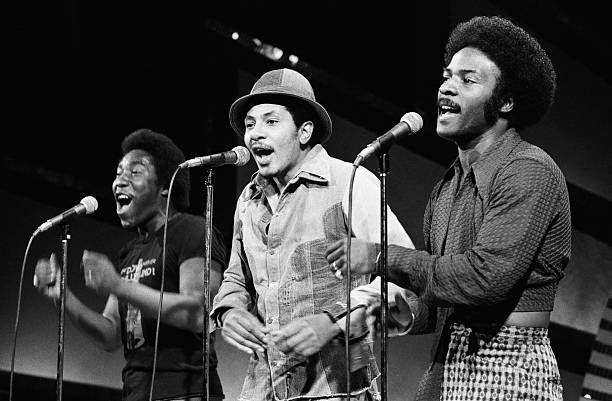 """<p>First called The Mascots, then The Triumphs, The O'Jays were a group of young men who started out as Gospel singers. They formed a group in 1957, while they were still in high school, eventually adopting their new name in 1963 from a Cleveland DJ Eddie O'Jay, who loved their sound and helped the group get an agent (who then got them a label!). They toured extensively until hitting it big with """"<a href=""""https://www.amazon.com/Back-Stabbers/dp/B00137QTS6/?tag=syn-yahoo-20&ascsubtag=%5Bartid%7C10063.g.35225069%5Bsrc%7Cyahoo-us"""" rel=""""nofollow noopener"""" target=""""_blank"""" data-ylk=""""slk:Back Stabbers"""" class=""""link rapid-noclick-resp"""">Back Stabbers</a>"""" in 1972. The song highlighted their outstanding harmonies and was followed by many other hits including <a href=""""https://www.amazon.com/Love-Train/dp/B00137V04Y/?tag=syn-yahoo-20&ascsubtag=%5Bartid%7C10063.g.35225069%5Bsrc%7Cyahoo-us"""" rel=""""nofollow noopener"""" target=""""_blank"""" data-ylk=""""slk:&quot;Love Train&quot;"""" class=""""link rapid-noclick-resp"""">""""Love Train""""</a>, which some experts call the first disco song, and """"<a href=""""https://www.amazon.com/I-Love-Music/dp/B00137YNL6/?tag=syn-yahoo-20&ascsubtag=%5Bartid%7C10063.g.35225069%5Bsrc%7Cyahoo-us"""" rel=""""nofollow noopener"""" target=""""_blank"""" data-ylk=""""slk:I Love Music"""" class=""""link rapid-noclick-resp"""">I Love Music</a>."""" </p>"""