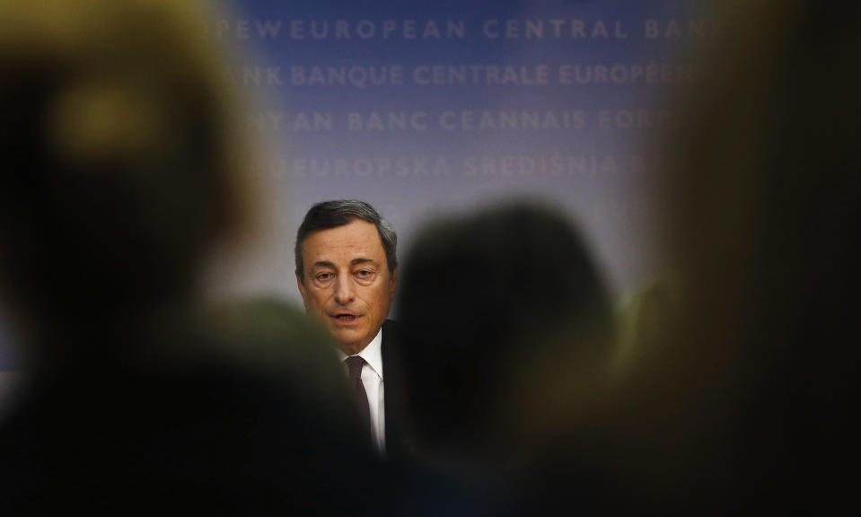 Mario Draghi, President of the European Central Bank (ECB), addresses the media during the ECB's monthly news conference in Frankfurt, September 4, 2014. The ECB cut interest rates to a fresh record low on Thursday and launched a new scheme to push money into the flagging euro zone economy. In a series of measures underscoring growing concern about the currency bloc's health, the ECB cut its main refinancing rate to 0.05 percent from 0.15 percent previously and drove the overnight deposit rate deeper into negative territory, now charging banks 0.20 percent to park funds with it. REUTERS/Kai Pfaffenbach (GERMANY - Tags: BUSINESS HEADSHOT)