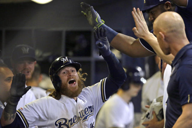 Milwaukee Brewers' Ben Gamel is congratulated in the dugout after hitting an inside-the-park home run during the sixth inning of the team's baseball game against the Seattle Mariners on Wednesday, June 26, 2019, in Milwaukee. (AP Photo/Aaron Gash)