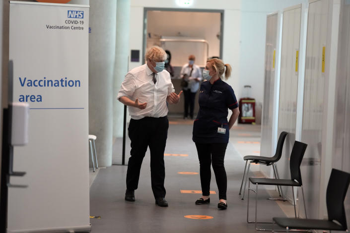 FILE - In this June 3, 2021, file photo, British Prime Minister Boris Johnson walks with Debs Scott, Clinical lead for UCLH's mass vaccination centre, after receiving his second jab of the AstraZeneca coronavirus vaccine, at the Francis Crick Institute in London. Helping countries recover from the coronavirus pandemic will be at the top of the agenda for the Group of Seven summit when Johnson welcomes President Joe Biden and the leaders of France, Germany, Italy, Japan and Canada to the cliff-ringed Carbis Bay beach resort in southwestern England on Friday, June 11. (AP Photo/Matt Dunham, Pool, File)