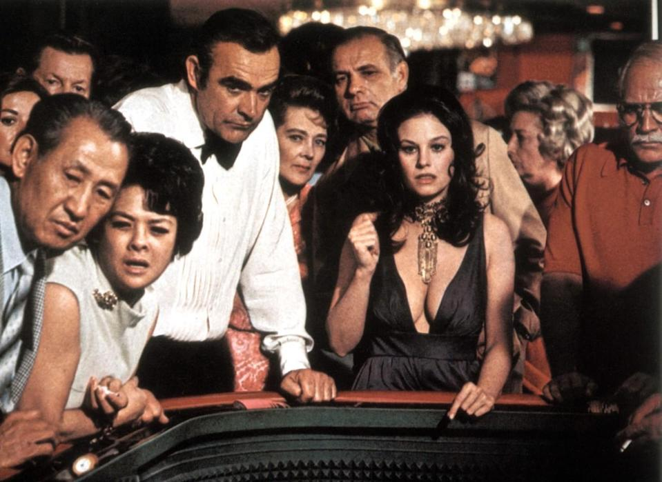<p>This unfortunately named Bond girl has a similarly unlucky fate: After seducing Bond at a casino craps table and going up to his room, the couple is ambushed by gangsters and the pretty brunette is thrown out a window. Off-screen, Wood is the younger sister of film star Natalie Wood. <i>(Photo: Everett Collection)</i></p>