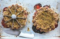 """A pistachio-oat crumble, perfumed with fragrant, floral cardamom adds interest to this juicy fruit pie. <a href=""""https://www.epicurious.com/recipes/food/views/strawberry-pistachio-crumble-pie?mbid=synd_yahoo_rss"""" rel=""""nofollow noopener"""" target=""""_blank"""" data-ylk=""""slk:See recipe."""" class=""""link rapid-noclick-resp"""">See recipe.</a>"""