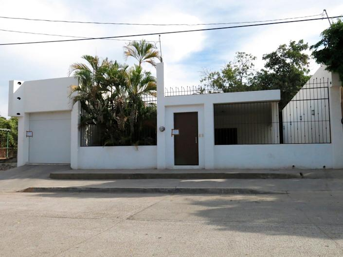 """This Feb. 23, 2014 file photo shows one of the properties that was interconnected by tunnels in the drainage system which the infamous drug kingpin Joaquin Guzman Loera known as """"El Chapo"""" used to evade authorities through an escape hatch in Culiacan, Mexico."""