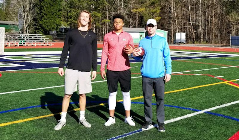 Trevor Lawrence and Justin Fields pose for a photo with Chandler Whitmer (R) after a workout at Harrison High School in Georgia. (Photo credit: Chandler Whitmer)
