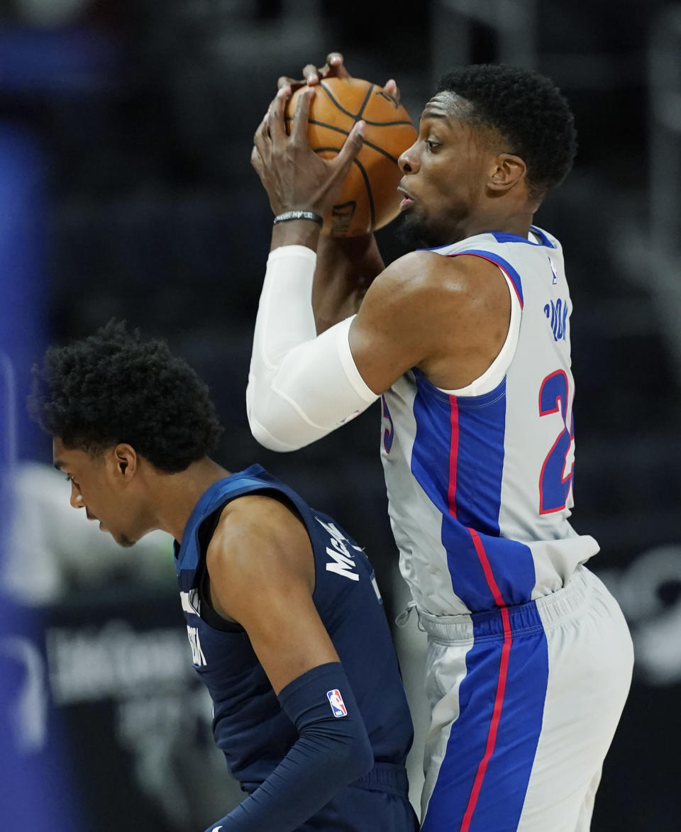 Detroit Pistons forward Tyler Cook controls the ball behind Minnesota Timberwolves guard Jordan McLaughlin during the second half of an NBA basketball game, Tuesday, May 11, 2021, in Detroit. (AP Photo/Carlos Osorio)