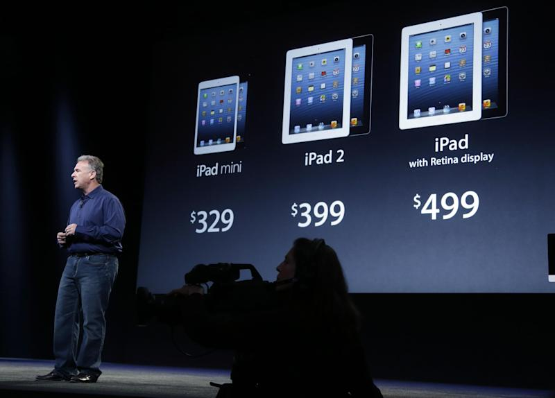 Phil Schiller, Apple's senior vice president of worldwide product marketing, displays the prices of the company's various iPad products in San Jose, Calif., Tuesday, Oct.  23, 2012. Apple Inc. is refusing to compete on price with its rivals in the tablet market,  it's pricing its new, smaller iPad well above the competition. On Tuesday, the company revealed the iPad Mini, with a screen that's about two-thirds the size of the full-size model, and said it will cost $329 and up. (AP Photo/Marcio Jose Sanchez)