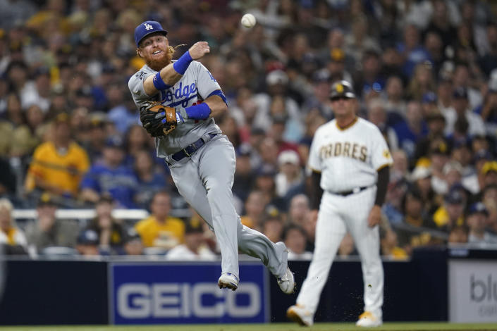 Los Angeles Dodgers third baseman Justin Turner throws to first for the out on San Diego Padres' Austin Nola during the fourth inning a baseball game Wednesday, Aug. 25, 2021, in San Diego. (AP Photo/Gregory Bull)