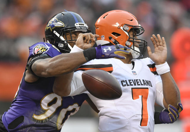 Baltimore Ravens defensive end Za'Darius Smith (90) knocks the ball loose from Cleveland Browns quarterback DeShone Kizer (7) during the second half of an NFL football game, Sunday, Dec. 17, 2017, in Cleveland. Ravens nose tackle Brandon Williams scored on the 1-yard fumble recovery. (AP Photo/David Richard)