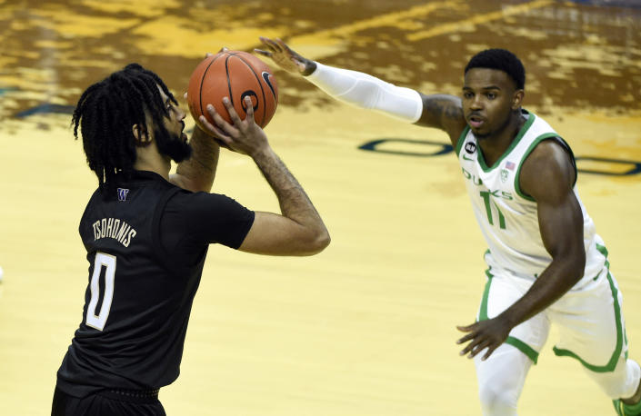 Washington guard Marcus Tsohonis (0) shoots over Oregon guard Amauri Hardy (11) during the first half of an NCAA college basketball game Saturday, Feb. 6, 2021, in Eugene, Ore. (AP Photo/Andy Nelson)