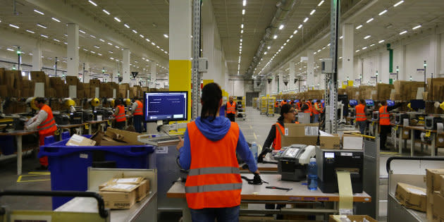 Workers handle items for delivery at an Amazon distribution center near Berlin, Germany, Nov. 28, 2013. Amazon is planning to build a one million-square-foot distribution centre in Ottawa's east end, according to news reports.