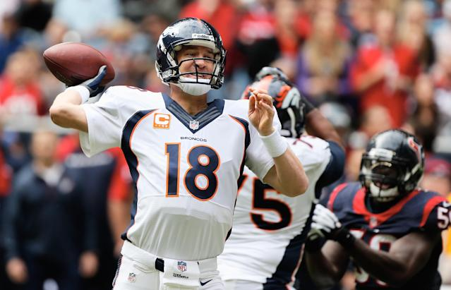 HOUSTON, TX - DECEMBER 22: Peyton Manning #18 of the Denver Broncos drops back to pass during the first half of the game against the Houston Texans at Reliant Stadium on December 22, 2013 in Houston, Texas. (Photo by Scott Halleran/Getty Images)