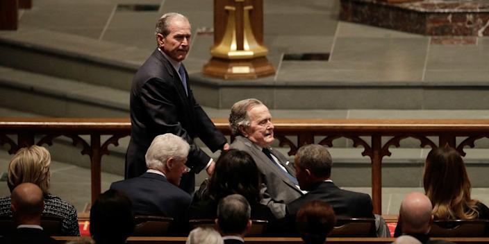 Former Presidents George W. Bush and George H.W. Bush arrive for the funeral for former first lady Barbara Bush on April 21, 2018.