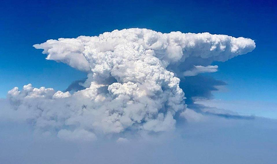 A handout photo made available by the US Forest Service (USFS) shows an aerial view of a pyrocumulus cloud billowing from the Bootleg Fire, taken by the 141st Air Refueling Wing Washington Air National Guard, in southern Oregon, USA, 14 July 2021 (issued 20 July 2021). According to the USFD, over 2,000 firefighters in the US state of Oregon are battling the Bootleg Fire, a large active wildfire that has burned over 300,000 acres, prompting the evacuation of thousands. Bootleg Fire in southern Oregon, USA - 14 Jul 2021