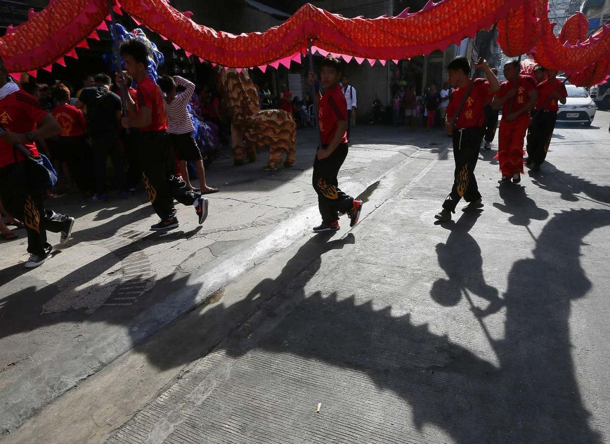 Dragon dancers prepare to perform in front of a business establishment in celebration of the Chinese Lunar New Year, Saturday, Jan. 28, 2017, in the Chinatown area of Manila, Philippines. This year is the Year of the Rooster on the Chinese lunar calendar. (AP Photo/Bullit Marquez)