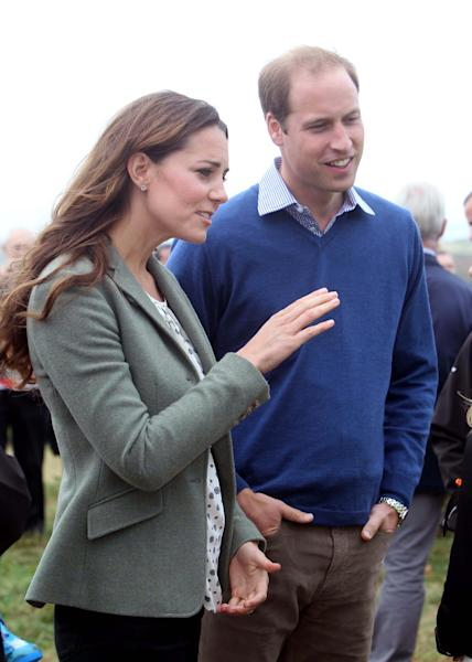 Britain's Duke and Duchess of Cambridge arrive at Breakwater Country Park for the start of the Ring O' Fire Anglesey Coastal Ultra Marathon, a three-day, 135-mile foot race around the rugged coast of Anglesey, Wales, Friday, Aug. 30, 2013. Kate, Duchess of Cambridge, made her first public appearance since the birth of Prince George as she joined husband Prince William at the event (AP Photo / Paul Lewis, Pool)