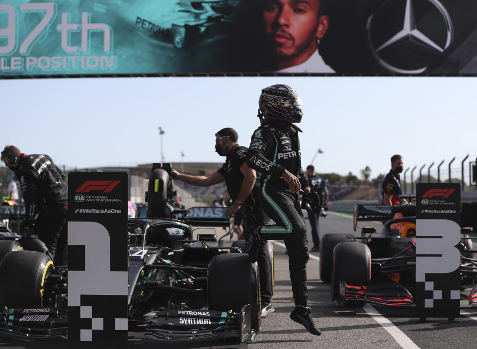 Mercedes driver Lewis Hamilton of Britain gets out of his car after clocking the fastest time during qualification for the Formula One Portuguese Grand Prix at the Algarve International Circuit in Portimao, Portugal, Saturday, Oct. 24, 2020. The Formula One Portuguese Grand Prix will take place on Sunday. (Jose Sena Goulao, Pool via AP)