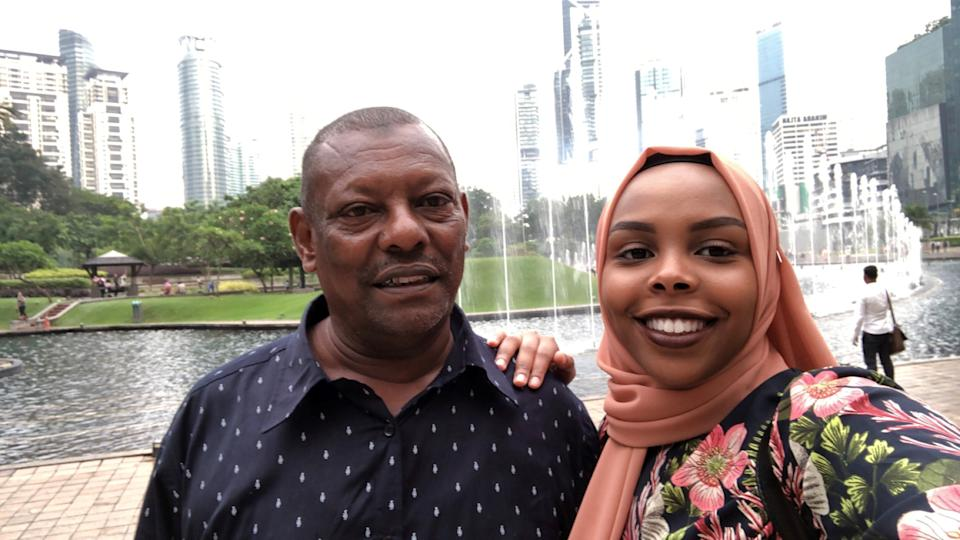 """Afnan Salem visiting her father in Malaysia on July 2019. Salem's father has been unable to reunite with his family in the US because of Trump's Muslim and African ban.<span class=""""copyright"""">Courtesy of Afnan Salem</span>"""