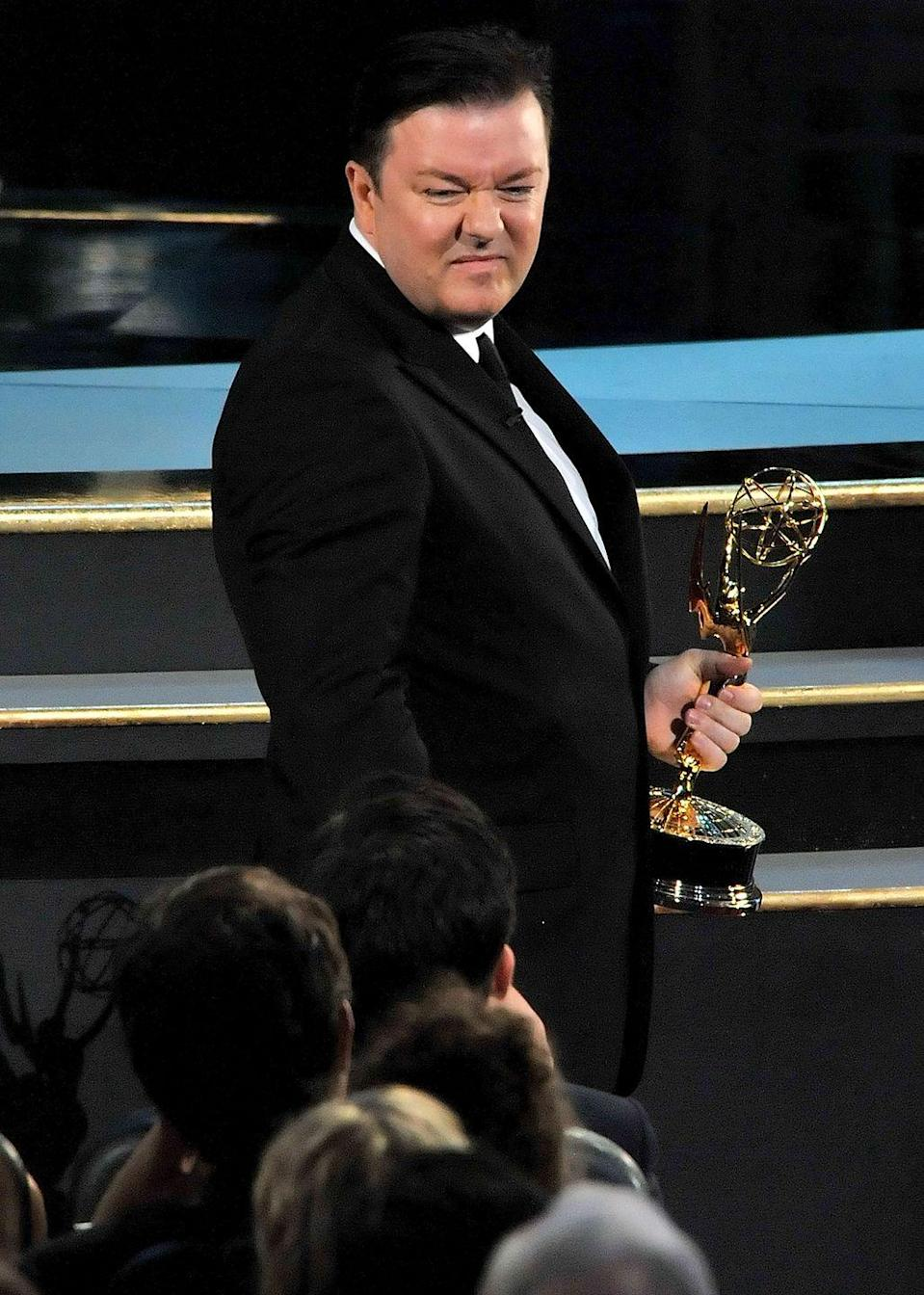 """<p>In 2007, Ricky Gervais won an Emmy award, but wasn't there to claim it, so Steve Carrell accepted it for him. In 2008, Gervais was at the Emmys... and he was not pleased that Carrell accepted his Emmy. In a very funny skit, Gervais tore Carrell down before <a href=""""https://www.youtube.com/watch?v=RZp6cR4bxbY"""" rel=""""nofollow noopener"""" target=""""_blank"""" data-ylk=""""slk:demanding his Emmy back"""" class=""""link rapid-noclick-resp"""">demanding his Emmy back</a>. </p>"""