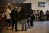 The Rev. Marcus Murchinson, second from left, and his church members pray with rehab residents after donating homemade cakes to celebrate Father's Day, Sunday, June 21, 2020, in the Watts neighborhood of Los Angeles. Churches are the heart of the Black community, Murchinson said. In addition to ministering to the faithful, churches provide food, clothing and recreation programs for children. Murchinson also runs a charter school and drug rehab clinics. (AP Photo/Jae C. Hong)