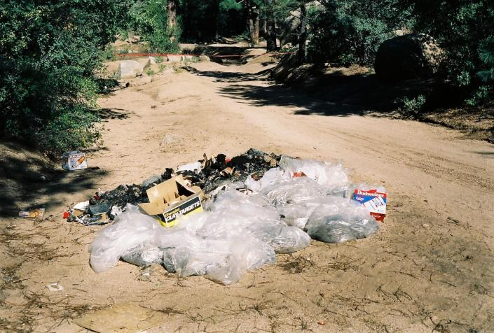 This undated photo provided by the Yavapai County Sheriff's Office shows the site outside Prescott, Arizona, where Pamela Pitts' body was found in 1988 among a pile of trash. Pitts' then-roommate, Shelly Harmon, recently confessed to killing her and was sentenced to time she already had served in another killing. (Yavapai County Sheriff's Office via AP)