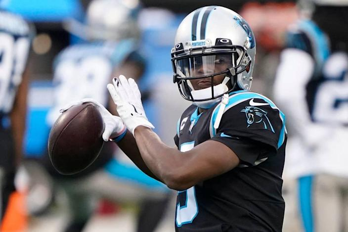 Carolina Panthers quarterback Teddy Bridgewater warms up before an NFL football game against the New Orleans Saints Sunday, Jan. 3, 2021, in Charlotte, N.C. (AP Photo/Brian Blanco)