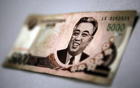 Photo illustration taken in Shanghai shows North Korean leader Kim Il-sung on a 5000 North Korea won banknote