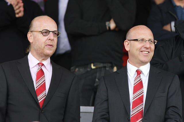 Joel Glazer, right, and Avram Glazer, are hoping to build bridges with Manchester United fans