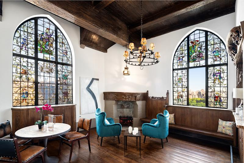 Residents of the penthouse get access to this unique tower, which features a wet bar, fireplace, and stained glass windows with views of Central Park.