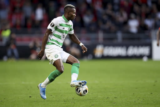 FILE - In this Thursday, Sept. 19, 2019 file photo, Celtic's Boli Bolingoli-Mbombo controls the ball during the Europa League Group E soccer match between Rennes and Celtic, at the Roazhon Park stadium in Rennes, France. Scottish soccer is in danger of being halted by the countrys government after a Celtic player breached coronavirus rules by taking a secret trip to Spain and failing to self-isolate on his return. The Scottish champions have begun a full investigation into the actions of left back Boli Bolingoli, it was reported on Tuesday, Aug. 11, 2020. (AP Photo/David Vincent, File)