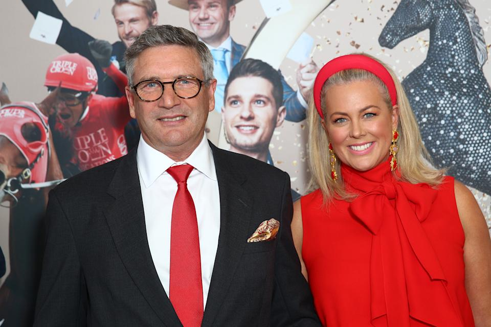 Richard Lavender and Samantha Armytage wearing a red dress and red hairband at Golden Eagle Day at Rosehill Gardens on October 31, 2020 in Sydney, Australia. (Photo by Don Arnold/WireImage)