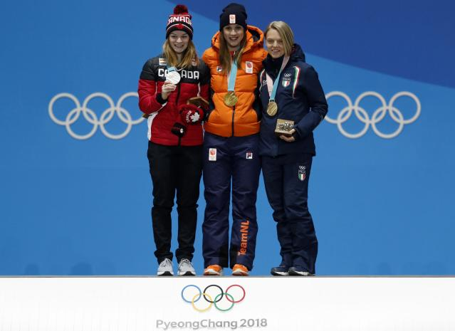Medals Ceremony - Short Track Speed Skating Events - Pyeongchang 2018 Winter Olympics - Women's 1000m - Medals Plaza - Pyeongchang, South Korea - February 23, 2018 - Gold medalist Suzanne Schulting of the Netherlands, silver medalist Kim Boutin of Canada and bronze medalist Arianna Fontana of Italy on the podium.