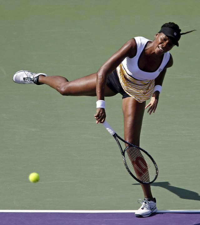 Venus Williams, of the United Staes, serves to Casey Dellacqua, of Australia, at the Sony Open tennis tournament in Key Biscayne, Fla., Sunday, March 23, 2014. (AP Photo/Alan Diaz)