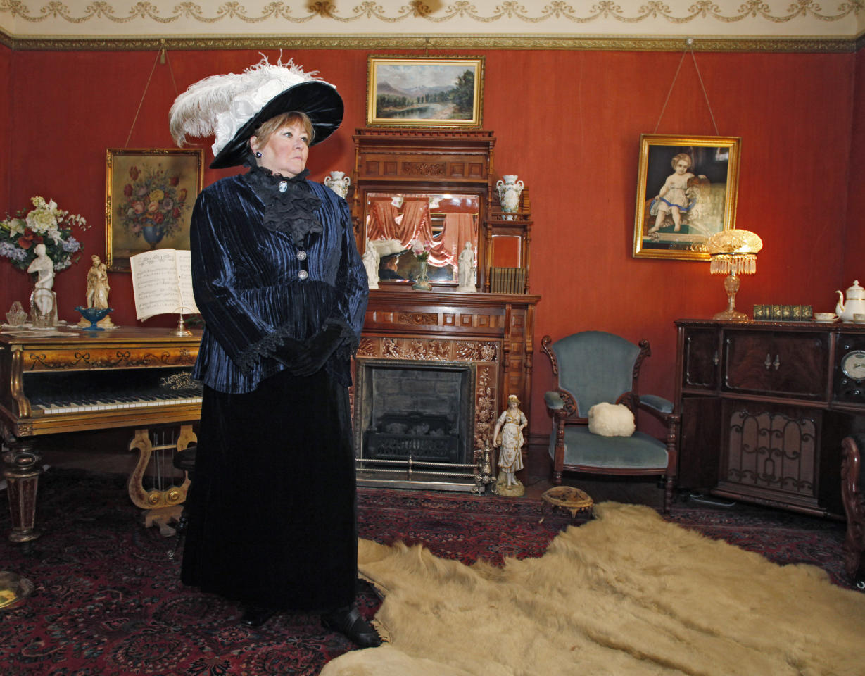 "This March 2, 2012 photo shows Janet Kalstrom, a retired banking project manager who been the museum's Molly Brown impersonator for six years in the living room at the Molly Brown House Museum. A few blocks from Colorado's state Capitol _ over 1700 miles from the Atlantic Ocean and a mile above sea level _ is a museum dedicated to a woman eclipsed by legend following the sinking of the Titantic. The ""unsinkable Molly Brown"" moved into this stone Victorian home after she and her husband struck it rich at a gold mine in Colorado's mountains, nearly 20 years before she boarded the Titanic because it was the first boat she could get back home to visit her ailing grandson. (AP Photo/Ed Andrieski)"