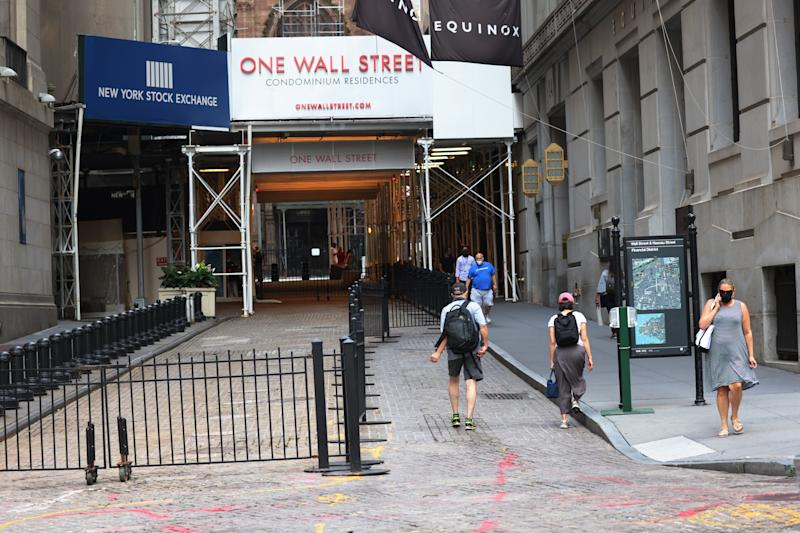 NEW YORK, NEW YORK - JULY 23: People walk along Wall Street near the New York Stock Exchange (NYSE) on July 23, 2020 in New York City. On Wednesday July 22, the market had its best day in 6 weeks. (Photo by Michael M. Santiago/.)