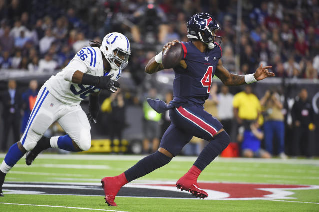 Houston Texans quarterback Deshaun Watson (4) looks to throw as he is chased by Indianapolis Colts defensive tackle Denico Autry (96) during the first half of an NFL football game Thursday, Nov. 21, 2019, in Houston. (AP Photo/Eric Christian Smith)