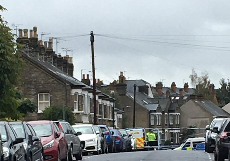 A police cordon on the street where the three bodies were found. (PA)